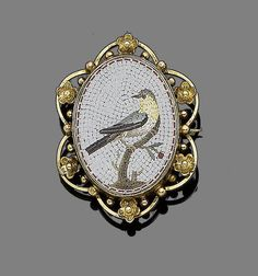 A micromosaic brooch Depicting a perching bird on a branch, within a later floral mount with beaded detail, length 3.8cm, sold $1043, 2012