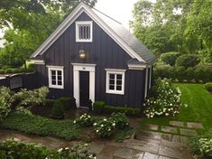 fabulous garage that looks like a guest cottage home makeovers - home renovation - beautiful garden by designer- Nancy Keyes