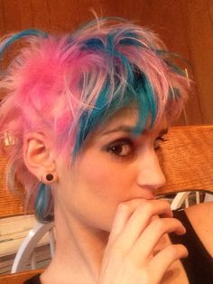 Pink and blue hair with sides shaved! Had this done at a hair show today.