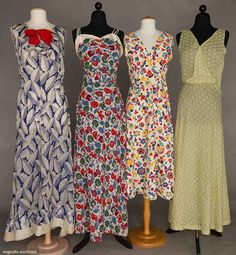 4 1930s Cotton Day Dresses 2 waffle-weave floral dresses. 1 Blue and white leaf pattern with red detailing. 1 green cotton