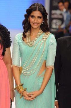 Sonam Kapoor at Her Best n Mint green Sari compliments her ..