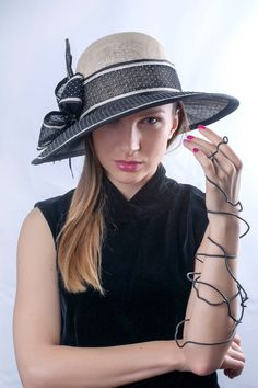 Gorgeous and elegant hat with sparkling ivory/black decor and wide asymmetric brim by Irina Sardareva