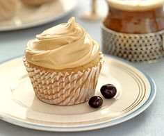 These grown-up cupcakes taste like a cup of coffee spiced with cinnamon and allspice. The creamy coffee frosting is easy to make adding instant coffee to canned white frosting.