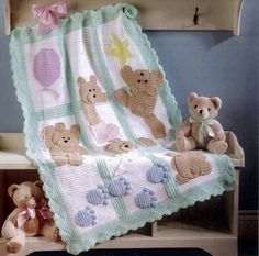 The Best of Mary Maxim Baby Afghans Book ~ personally, I would make the large background squares and just applique them with felted scraps of wool cut into desired shapes, with embroidered embellishments... or, work the colored shapes into the squares and then add embroidery, either way