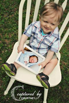 1 year photography session; newborn photo in the hands of the 1 year old! {Captured by Courtney}