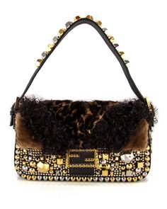 Is anything more fab than this Fendi Studded Fur Baguette ! ON SALE!    www.stanleykorshak.com ab392049be