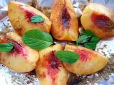 Roasted peaches with brown sugar, cinnamon, and fresh mint leaves.