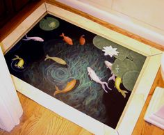 Fish pond painted floor cloth.  And here's how to make one!  http://blog.willardandmay.com/2012/02/24/weekend-diy-outdoor-rug/