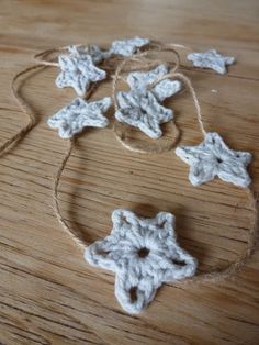 itty bitty stars - has great pictures and a tutorial -- strung on twine is pretty for itty bitty stars