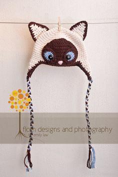 Siamese cat hat!  Sam would love this, it looks like Nana's Kiki :)