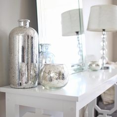 Glam coastal console table decor with mercury glass and mirrors for the summer season
