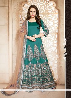 Add the sense of feminine splendor by this sea green banglori silk designer floor length suit. You could see some intriguing patterns completed with embroidered and resham work. Comes with matching bo...