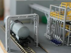 N Scale Chemical Storage Installation 3d printed Pipe bridge available separately. On the right you see the pump section for deliveries.