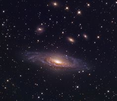 NGC 7331, a spiral galaxy in Pegasus --- is a spiral galaxy of some 100,000 light-years across, located about 49 million light-years away from Earth in the northern constellation of Pegasus (the Winged Horse), while it is receding from us at roughly 816 kilometers per second. It is the brightest member of the NGC 7331 Group of galaxies (also called the Deer Lick Group).