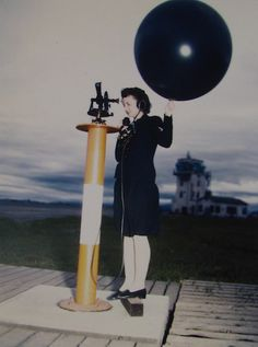Dorothy J. Baroch, aerologist's mate 3rd class, of Denver, operates a theodilite and weather balloon at Naval Air Station Moffett Field, California ~