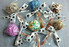 What a cute idea!  Cake pops for dogs and it looks like the stick is a rawhide chew.