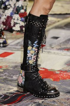 Alexander McQueen finds the perfect balance between feminine and edgy with these floral lace-up combat boots for the Spring 2017 collection.