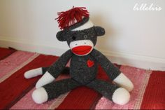"Amigurumi Sock-monkey – free pattern  From time immemorial, mothers and grandmothers have made simple sock monkeys for their kids and grandkids. This monkey was inspired by the movie ""Mr Magorium`s Wonder Emporium"" (2007)."