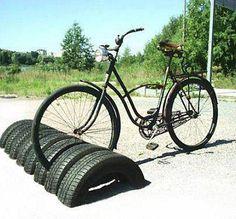 """Eenvoudig maar wel heel handig. (Pretty sure this means """"bike rack with old tires"""" in whatever language this is..... : )"""