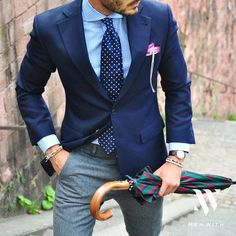 Navy blazer, grey trousers and coordinating navy/white tie