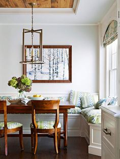 Love the exposed wood beams to define the banquette area, wood valance w/arch to frame the roman shades and light fixture