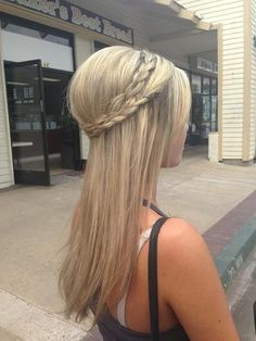 Straightened hair blonde over brown with a crown braid.