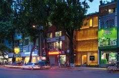 in the city of hanoi, vietnam, the vertical building by vo trong nghia is made up of perforated terracotta blocks regulating airflow throughout.