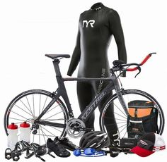 Triathlon gear essentials with running gear, biking gear, and swimming gear. Sprint triathlon training package for beginner triathletes new to swim, bike, run! Triathlon bike, cycling shoes, bike helmet, triathlon wetsuit for open water swimming, swim goggles, running hat, triathlon transition bag, triathlon training coach, and more included!