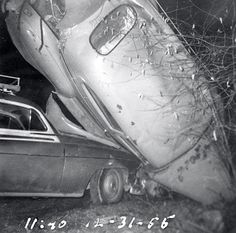 Wrecked 1941 Plymouth sedan lies in highway ditch atop 1952 Chevrolet station wagon following New Years Eve joyride drunk driving accident 11:40 PM 12-31-56. 1950s vernacular photo snapshot--http://reservatory.net