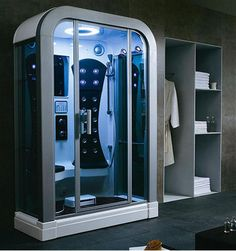 Futuristic Man Shower With Plane Interior And Great Blue Lighting White Minimalist Cabinet In Wall Fancy For Modern Bathroom