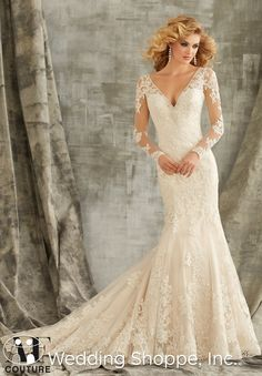 A beautiful and timeless long-sleeved lace wedding dress.