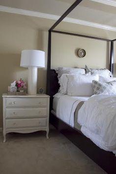 White bedside table/black bed