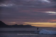 Patrolling - Surf and Ocean Art. Dawn patrols under a moody sky. Click for more surf and ocean art.
