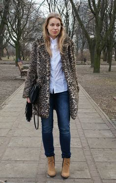 Shop this look on Lookastic:  http://lookastic.com/women/looks/jeans-ankle-boots-dress-shirt-fur-coat-crossbody-bag/9294  — Navy Jeans  — Tan Suede Ankle Boots  — White Dress Shirt  — Brown Leopard Fur Coat  — Black Leather Crossbody Bag