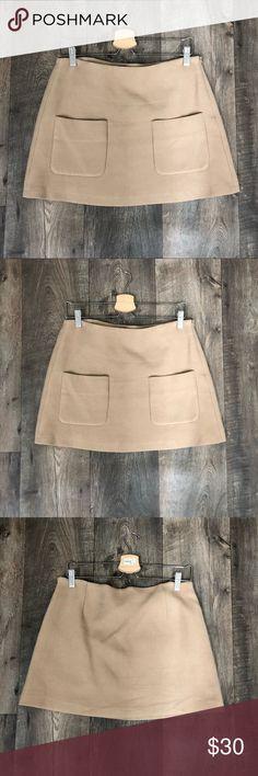 "NWOT Zara Mini skirt With Pockets Size Medium NWOT Zara tan mini skirt with pockets and side zipper. Size medium. Cotton exterior and viscose lining. Flat measurements: 16"" waist and 14.5"" length. Zara Skirts Mini"