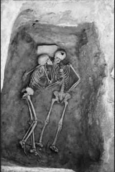 It is a little creepy, but this is true love!    The 6000 year old kiss found in Hasanlu, Iran.