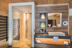 A bathroom from Wieser + Scherer from Zell am See. Bathroom Lighting, New Homes, Mirror, House, Furniture, Home Decor, Bath Room, Bathing, Showers