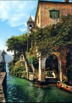 This is Lake Como, Italy and it is an upscale resort area which is known for its dramatic scenery The lake is in the shape of an upside-down Y. The town of Como is the home of Renaissance architecture. The town is well known for the town's natural beauty elegant old villas and the beautiful towns surrounding the lake.
