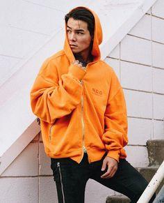 Ryan Potter in a cool orange sweatshirt