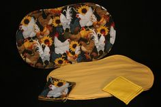 Special set of oval placemats and coasters. Chicken print on one side solid yellow on opposite