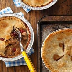 Individual Pork & Cranberry Potpies Recipe -My neighbor gave me this recipe years ago, and I love how these pies are different from the usual chicken pot pie. The flavor combination in these pies just screams fall, but freezing them allows my family to enjoy them any time of year. They are especially good for an easy dinner during the cold winter months.—Mary Shenk, Dekalb, Illinois