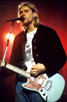 Kurt Cobain, I wish I could have known him, kissed his face, and told him everything would be okay.