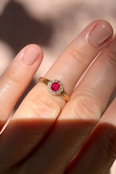 Edwardian ring set with an oval-cut ruby, surrounded by old mine-cut diamonds. Mounted in yellow gold. With British hallmarks dating the ring Gold Ring Designs, Gold Earrings Designs, Gold Jewellery Design, Piercings, Gold Rings Jewelry, Diamond Jewelry, Ruby Jewelry, Fine Jewelry, Jewelry Making