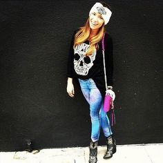 Skull jumper in black, CARMAR blue orbit super stretch jeans accessorized with exclusively ours Shane boots and a jeweled turban headband