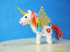Crocheted rainbow unicorn.  He's so cute.