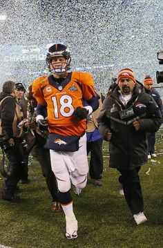 EAST RUTHERFORD, NJ - FEBRUARY 02: Quarterback Peyton Manning #18 of the Denver Broncos walks off the field after their 43-8 loss to the Seattle Seahawks during Super Bowl XLVIII at MetLife Stadium on February 2, 2014 in East Rutherford, New Jersey. (Photo by Kevin C. Cox/Getty Images)