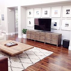 Gallery Wall. Pottery Barn Lee Gallery Frames, Restoration Hardware Printmaker's Media Console, Restoration Hardware Plinth Coffee Table, Rugs USA Tuscan Moroccan Shag Rug, Walnut Wood Floors, Fiddle Leaf Fig