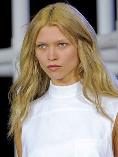 """Rather than spending hours working on models' hair, Redken Creative Consultant Guido took a less fussy approach. """"I wanted the hair to reflect the cool, low-key Alexander Wang girl. There are equal parts grunge and glamour, in that the hair is voluminous, yet natural,"""" he said. He blew the hair 75 percent dry, then misted on a cocktail of Redken Powder Refresh 01 and Quick Tease 15 to amp up the loose, undone texture."""