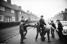 Ken Brown and Terry Venables playing football with some children in 1965, in the street where they both spent childhood years, Dagenham's Bonham Road.