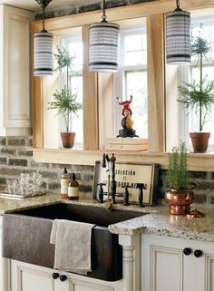 love the exposed brick backsplash and the farm house sink. I want exposed brick in my kitchen instead of tile. by elpida.pateraki.7